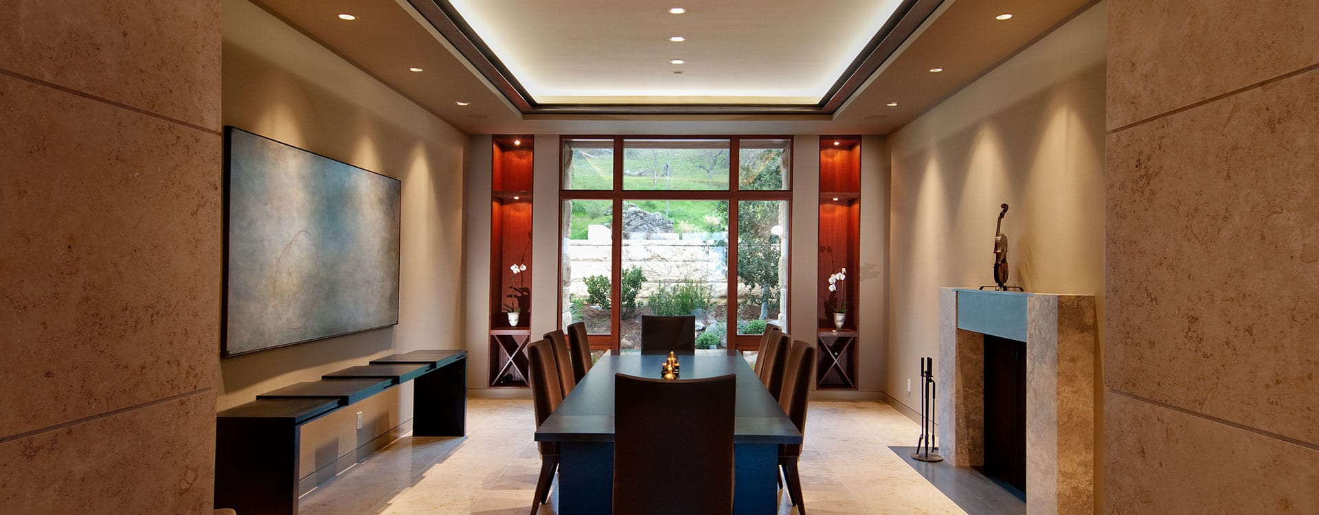 Modern bronze clad windows in dining room of a home on the Santa Lucia Preserve