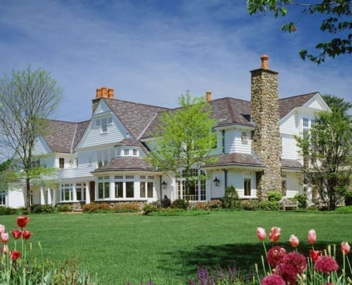Backview ofNew England manor in cedar and stone