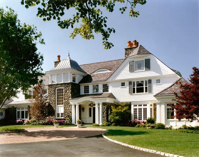 Front entry of New England style home with custom wood windows
