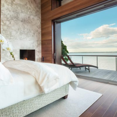 Pocketing lift and slide doors overlooking the harbour from a bedroom