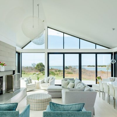 aluminum lift and slide doors in modern home by the water