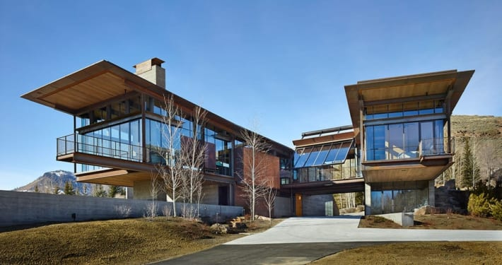 Panoramic modern mountain home with massive glass and steel windows and doors