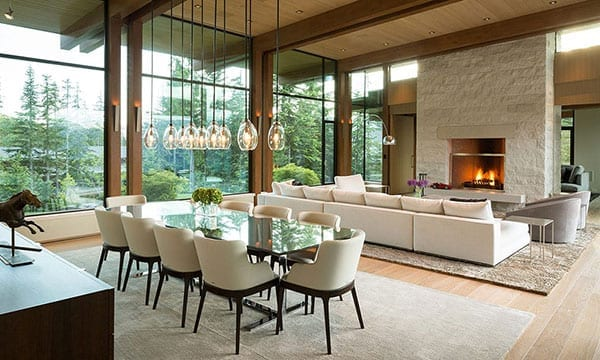 Modern dining room with large wood windows in the background