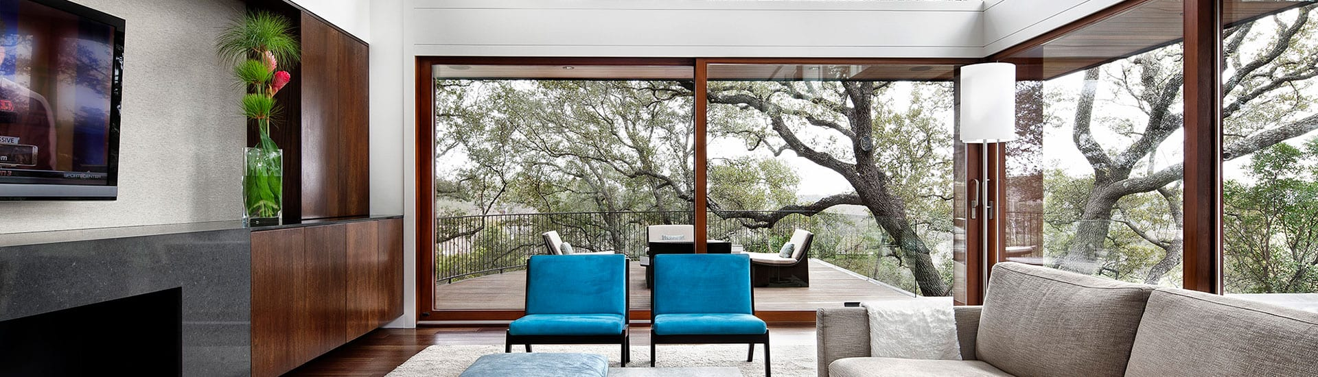Wood lift and slide doors with view to trees outside