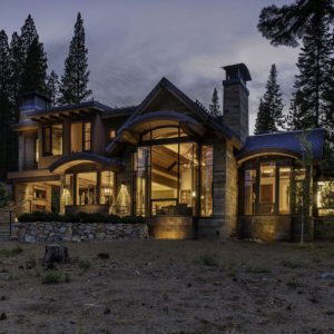 Modern wood windows viewed at night from outside a Lake Tahoe mountain home