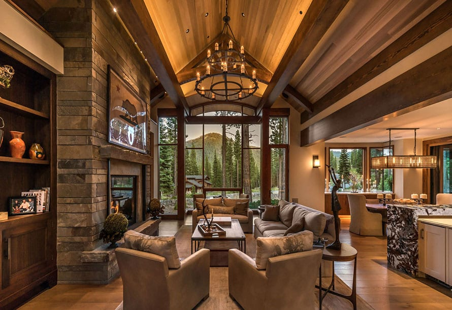 Looking out living room modern windows in Lake Tahoe mountain home